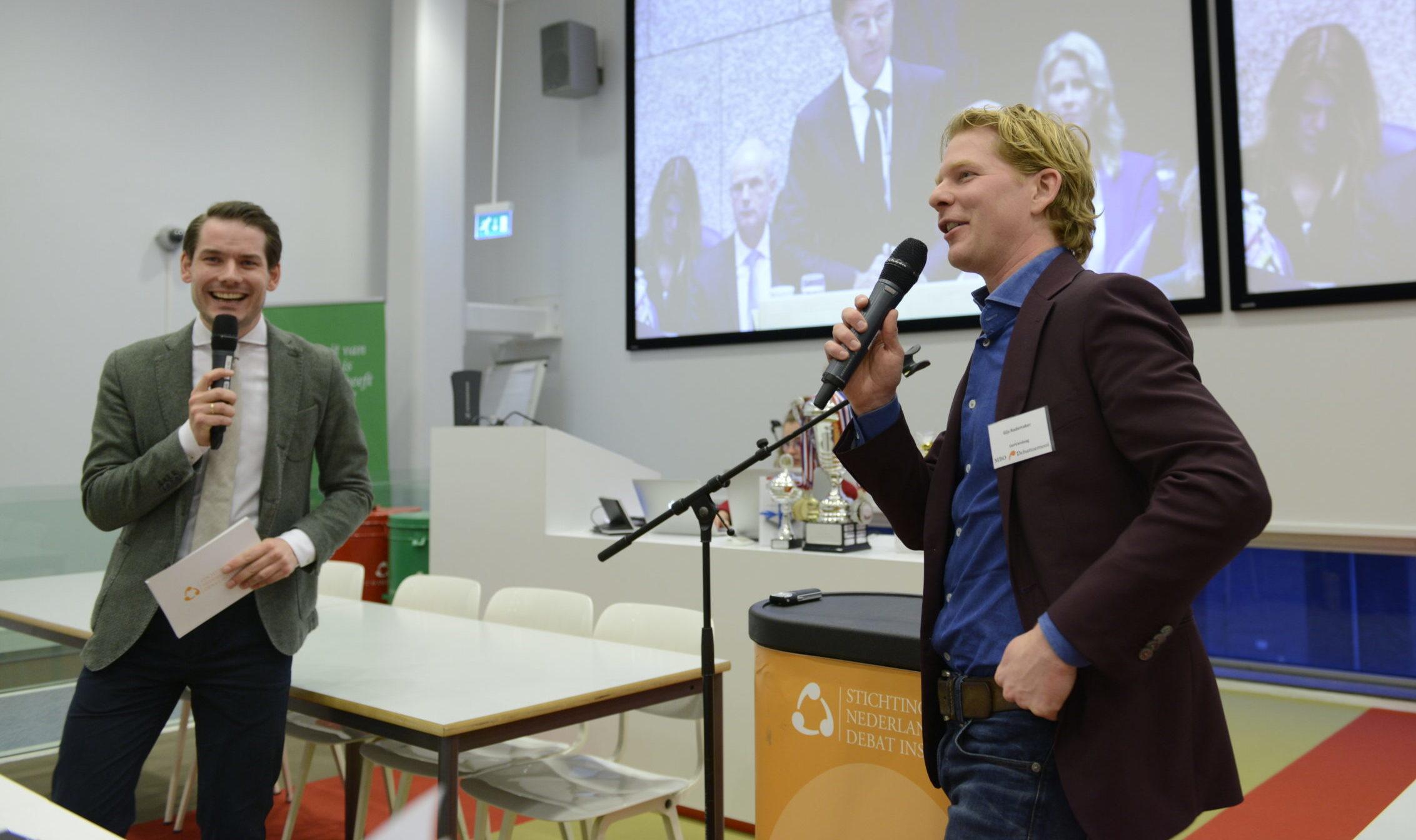 dagvoorzitter Nick Schoemaker tijdens interactieve lezing